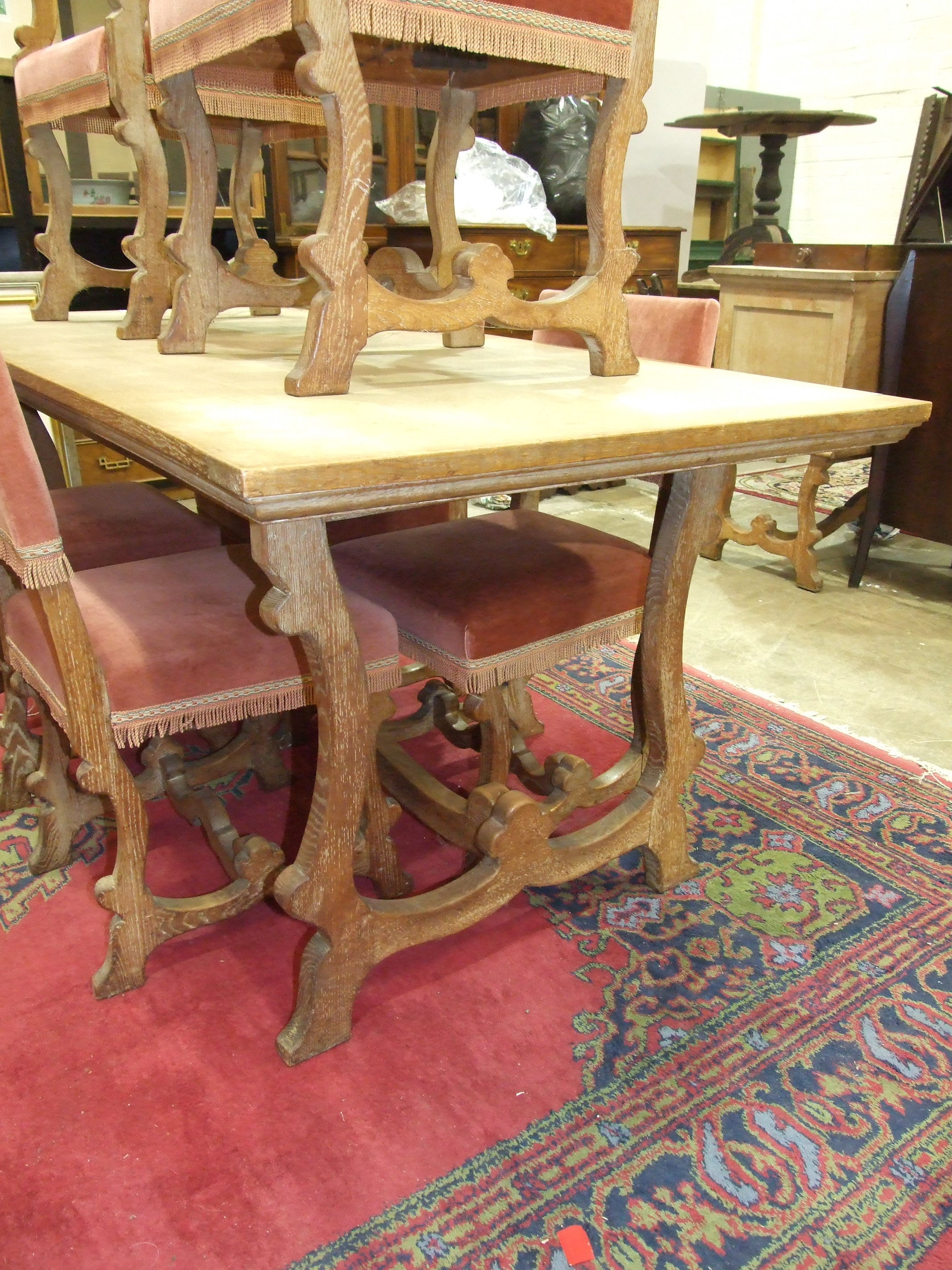 Lot 39 - A limed oak dining suite, comprising: a rectangular dining table, 181.5 x 86cm, a sideboard and