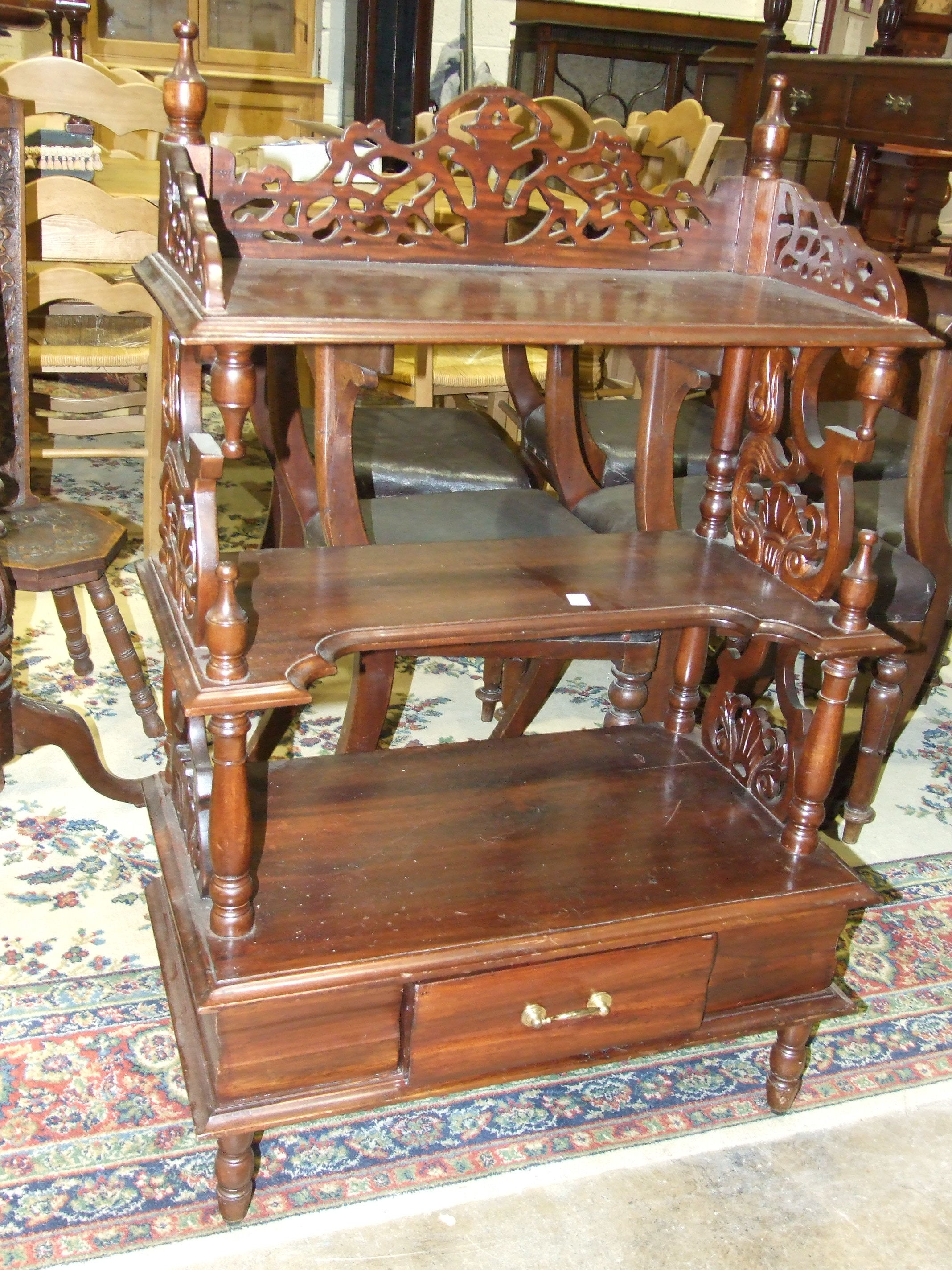 Lot 18 - A reproduction hardwood three-tier whatnot fitted with a drawer, 70 x 180cm and a reproduction