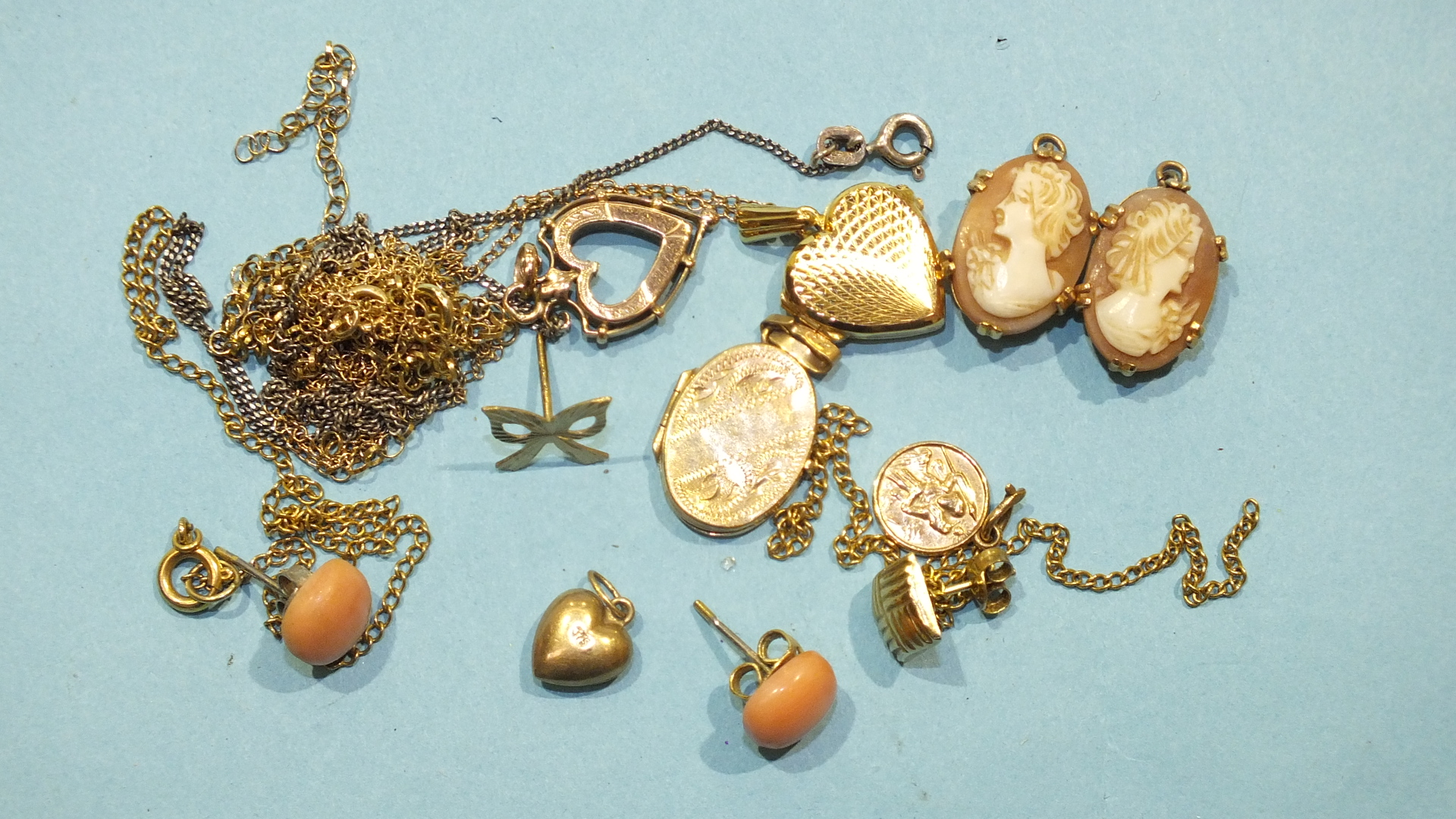 Lot 200 - Two matching cameo pendants, a pair of coral stud earrings and a small quantity of 9ct gold