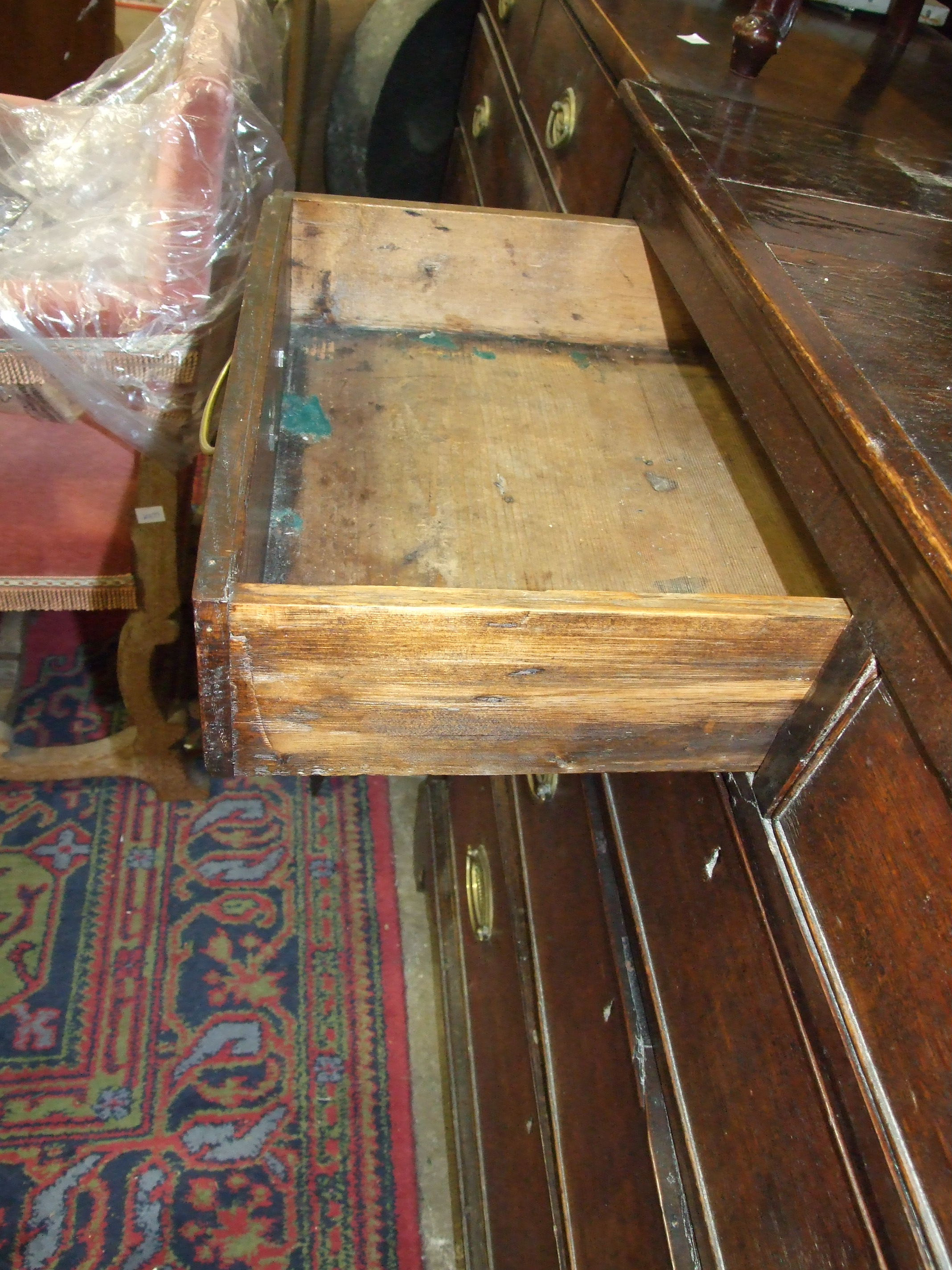 Lot 12 - An antique oak chest of two short and three long drawers, on bracket feet, 102cm wide.