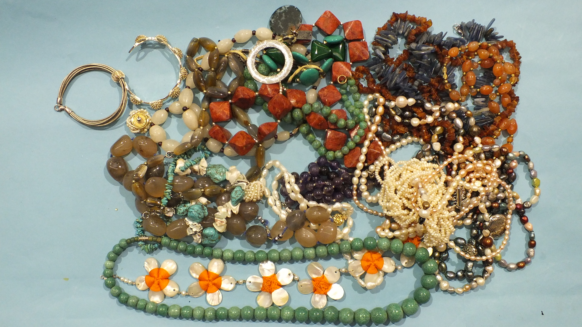 Lot 198 - A quantity of hardstone, freshwater pearl and other bead necklaces and two 925 silver bracelets.