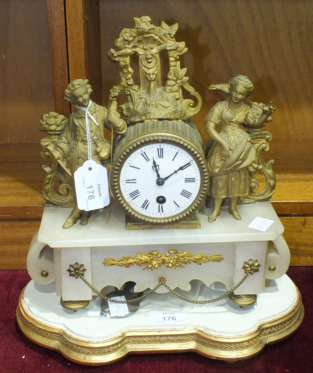 Lot 176 - A gilt metal and alabaster mantel clock with French drum movement, pendulum and key, 31cm high and a