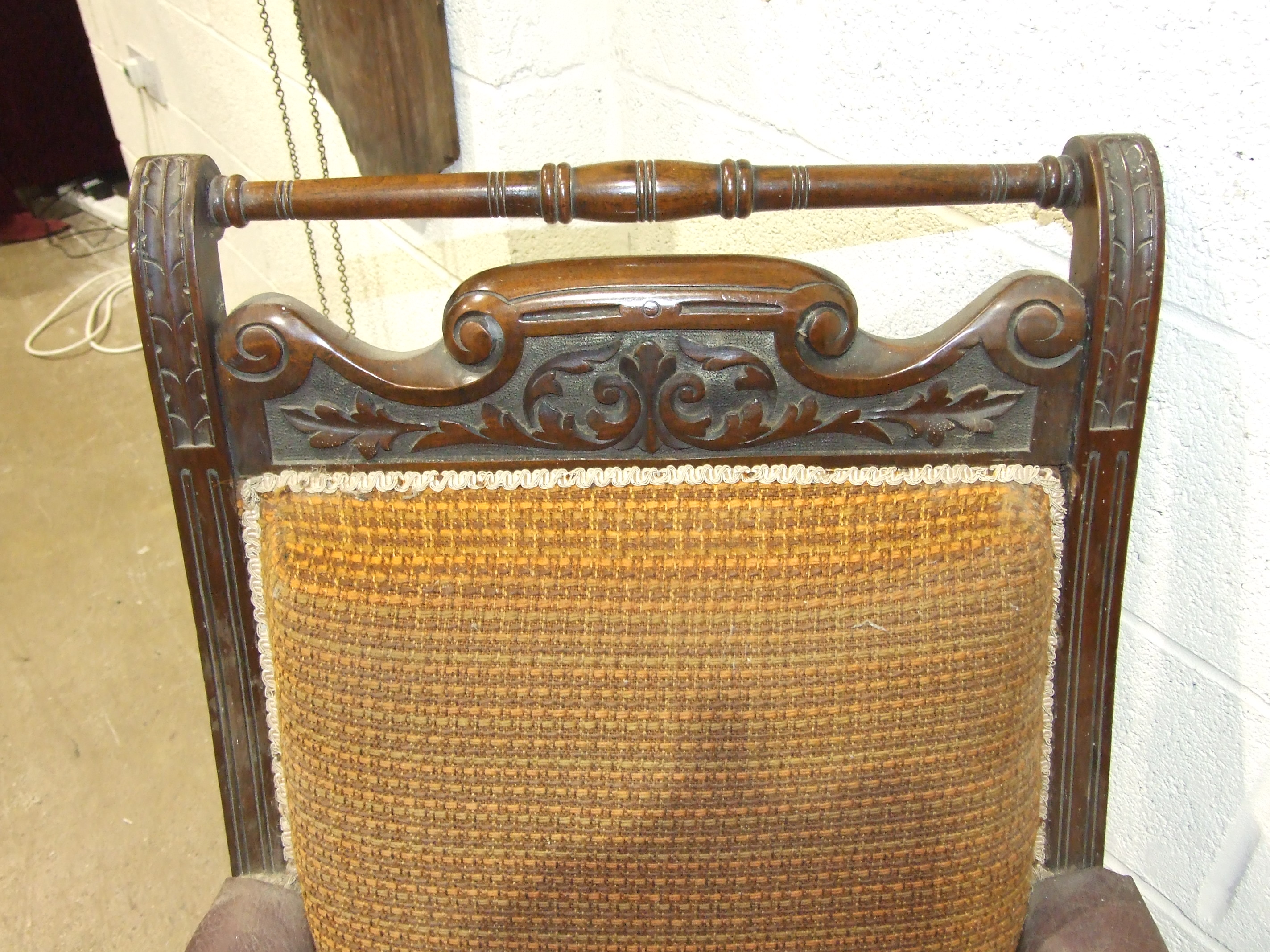 Lot 20 - A late Victorian carved walnut salon chair with upholstered back, seat and arm pads, on turned