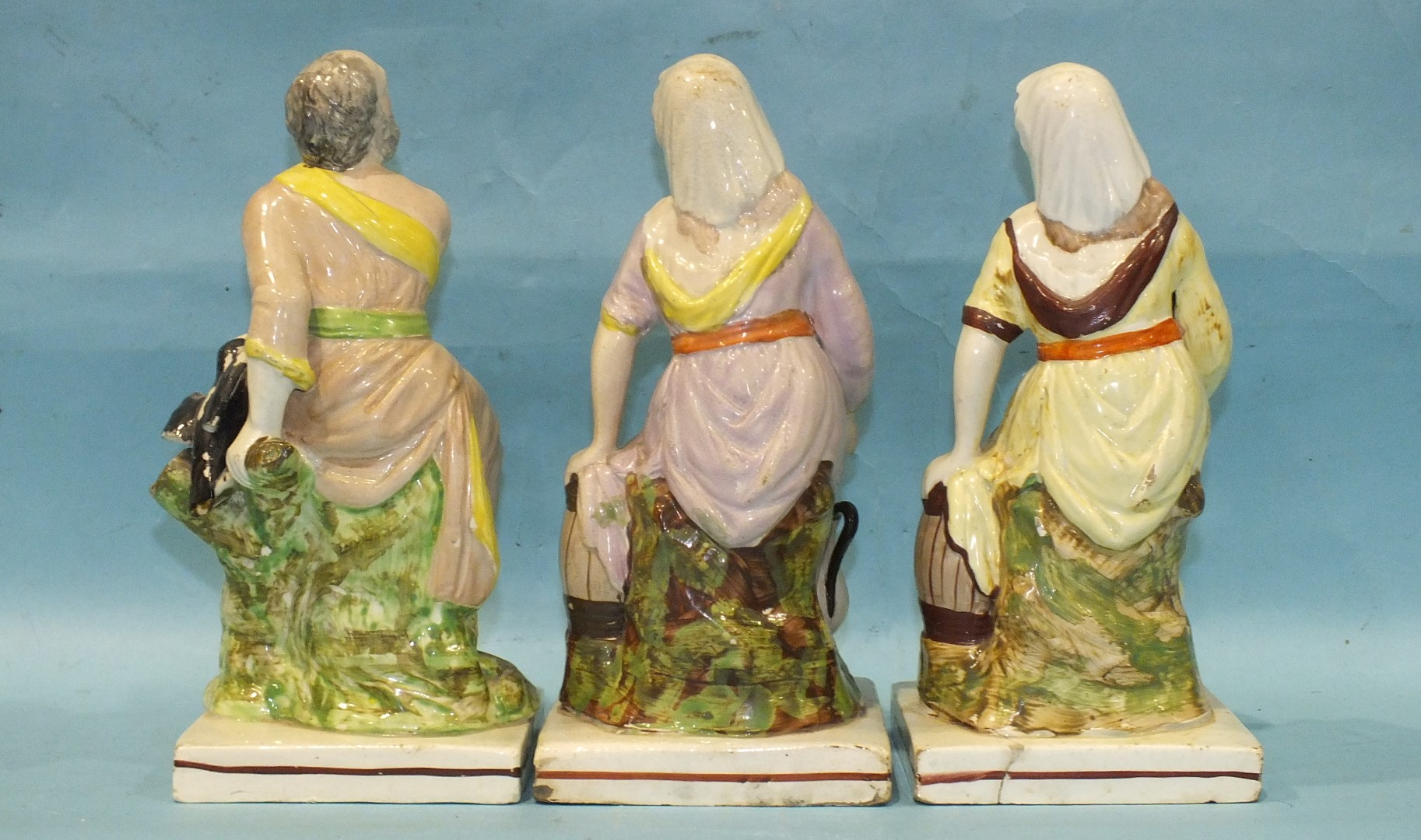 Lot 141 - A pair of early-19th century Staffordshire pearlware square-based figures of Elijah and the widow