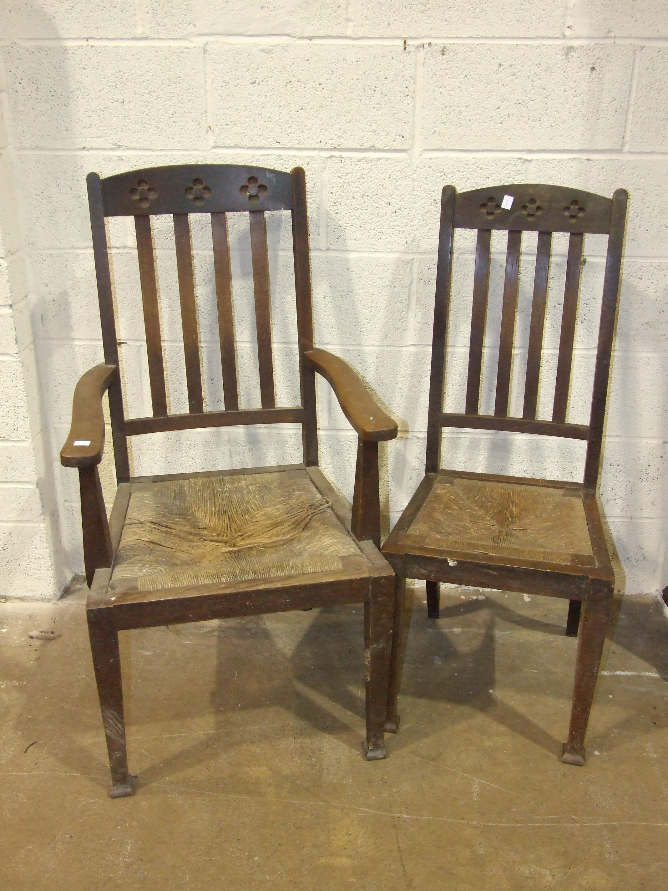Lot 22 - A set of six oak rush-seated dining chairs labelled James Mills, Brighton, (all in need of
