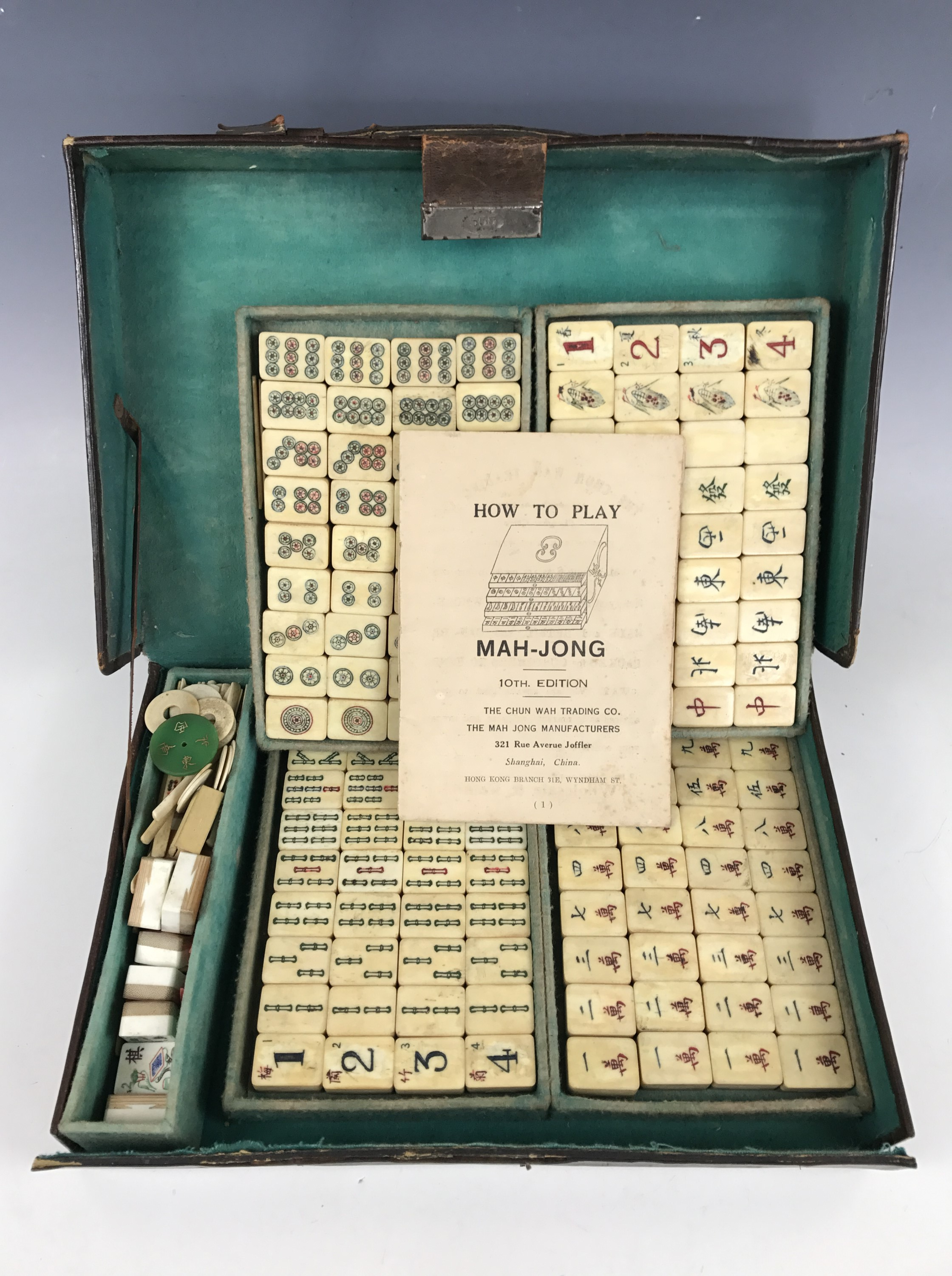 Lot 10 - An early 20th Century bone and bamboo Mah-Jong set manufactured and retailed by the Chun Wah Trading