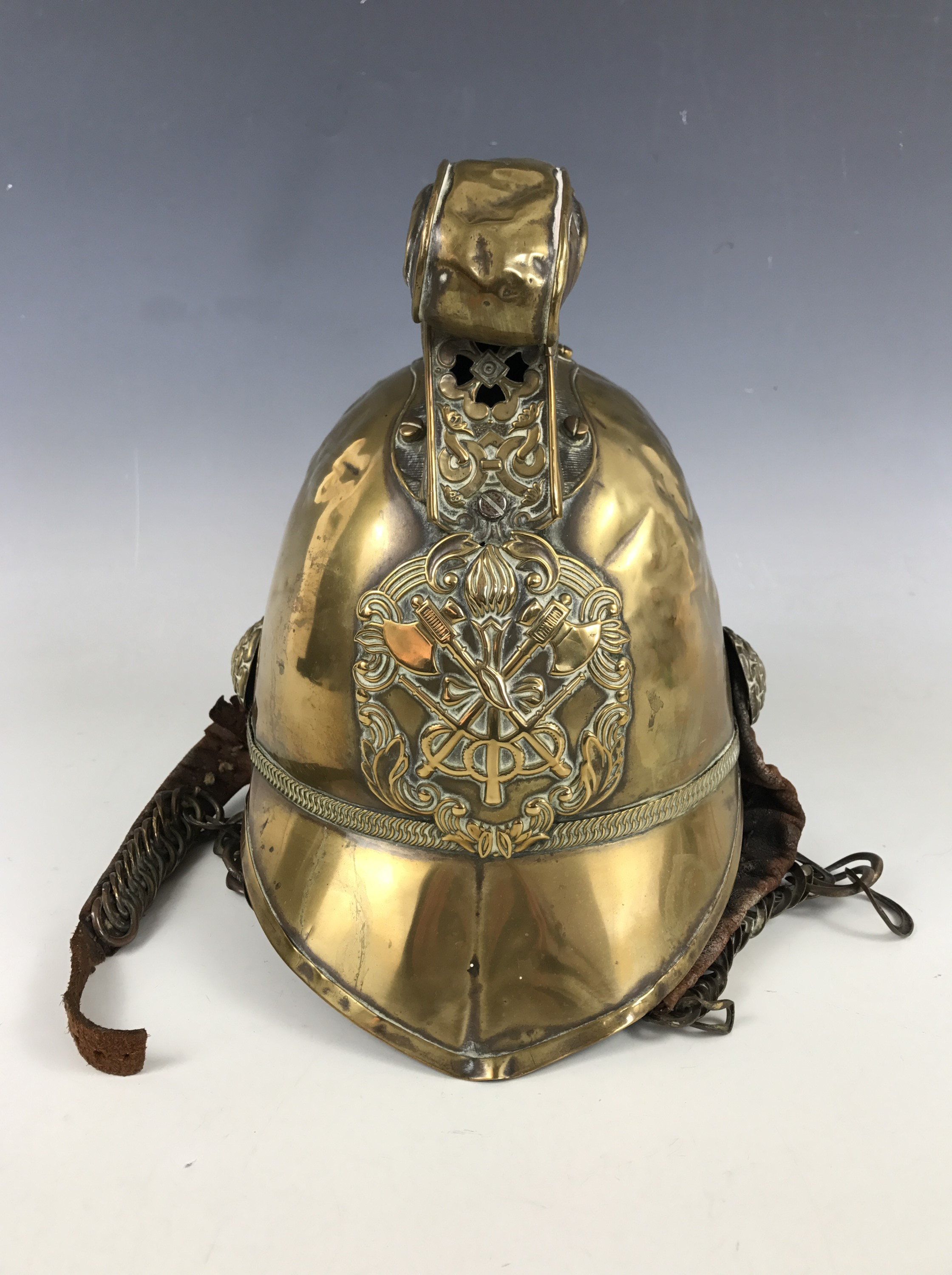 Lot 18 - A late 19th / early 20th Century Merryweather pattern fireman other ranks' brass helmet,