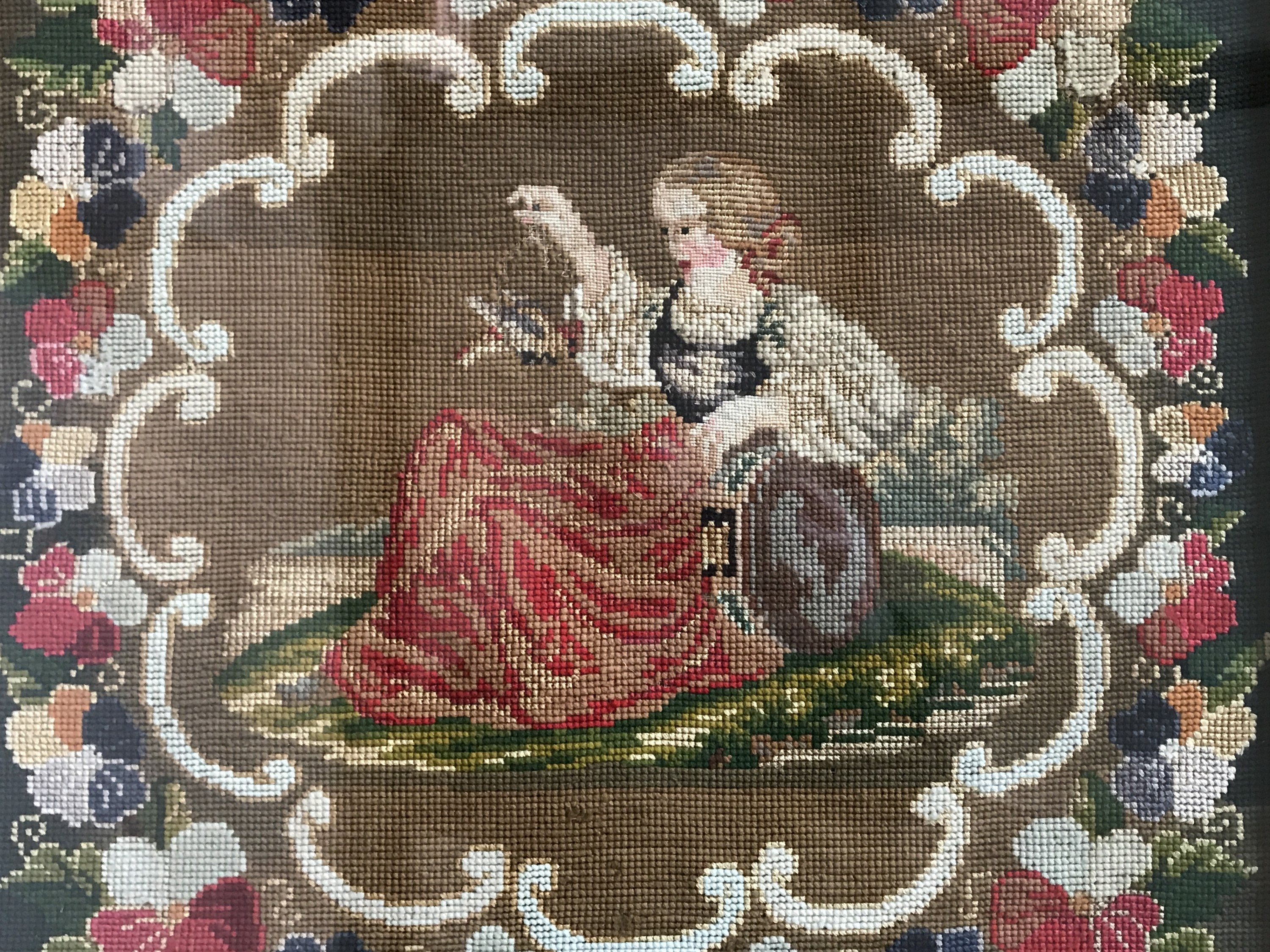 Lot 59 - A Victorian gros- and petit-point woolwork tapestry, depicting a recumbent young girl holding