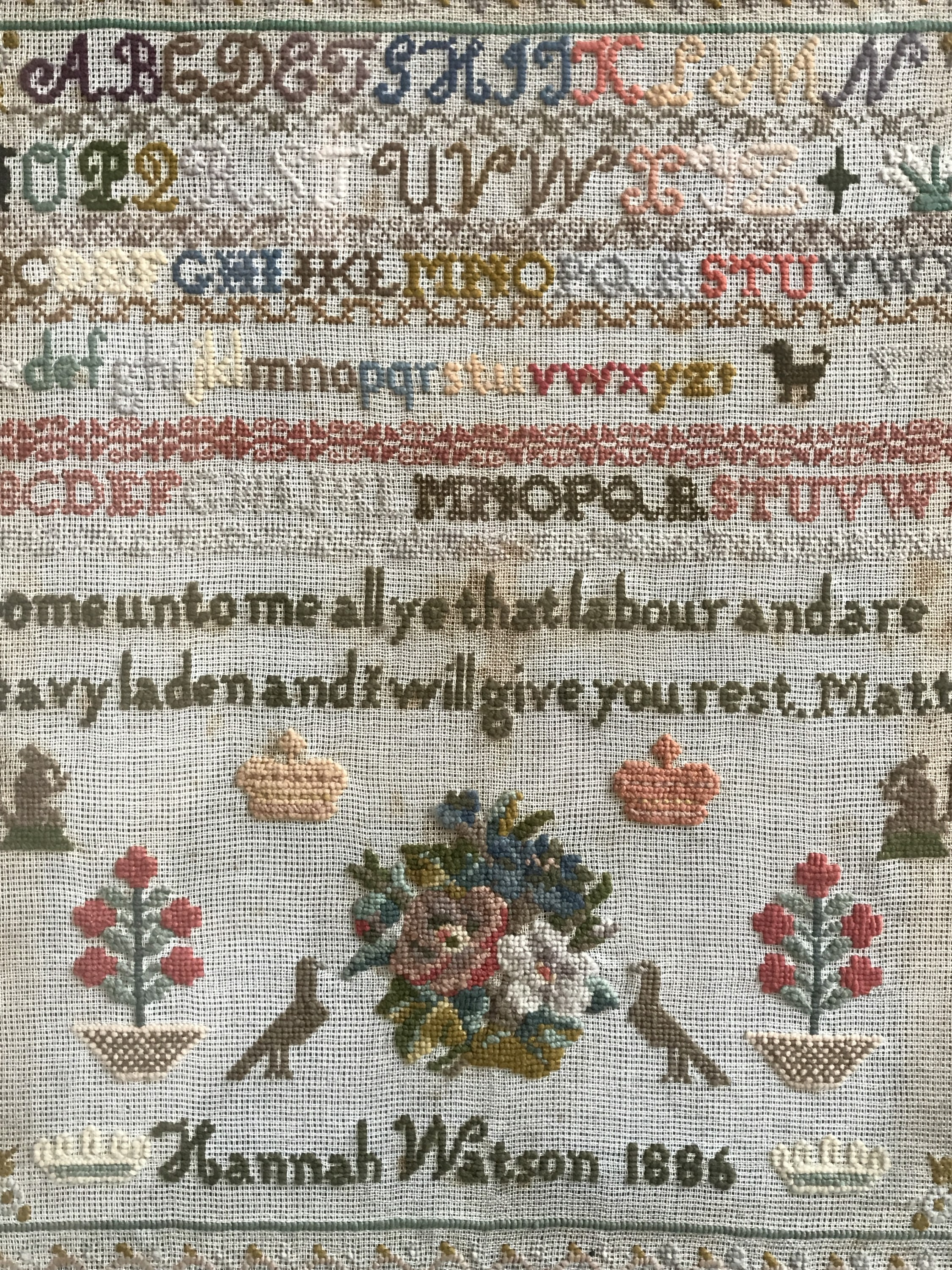 Lot 57 - A Victorian needlework sampler worked by Hannah Watson in 1886, wool threads over aida,