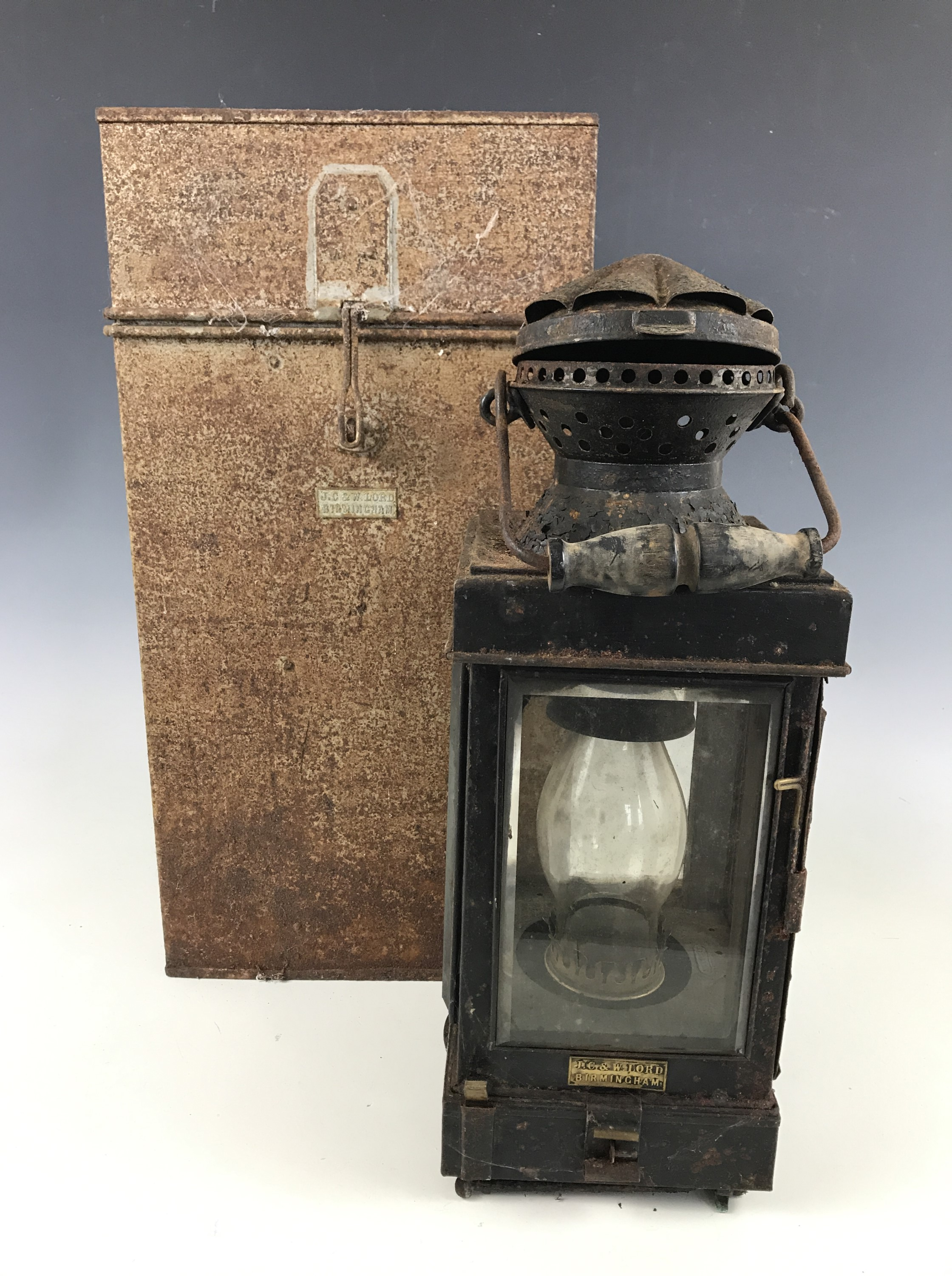 Lot 14 - A Victorian campaign paraffin / oil lamp by J C & W Lord of Birmingham, in tinplate transit case