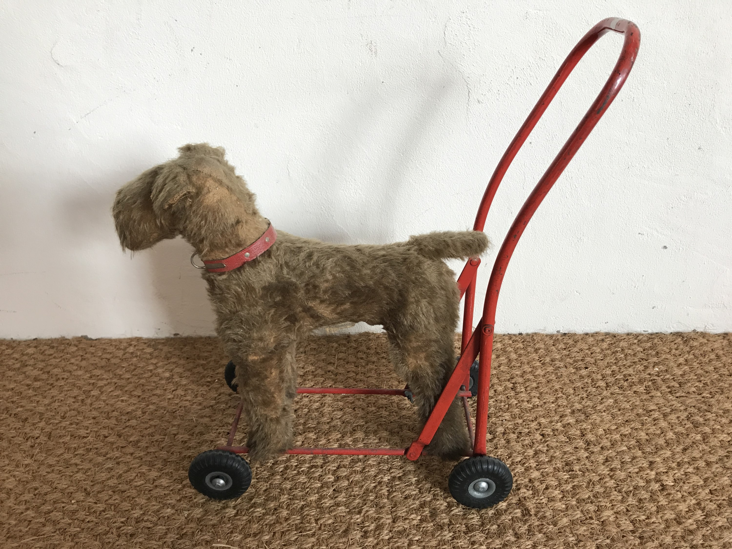Lot 51 - A Lines Brothers (Ireland) Ltd child's push along walker modelled as a fox terrier, mid-20th