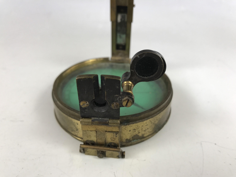 Lot 24 - A Victorian prismatic compass by Elliott Bros., Strand, London, 7.5 cm
