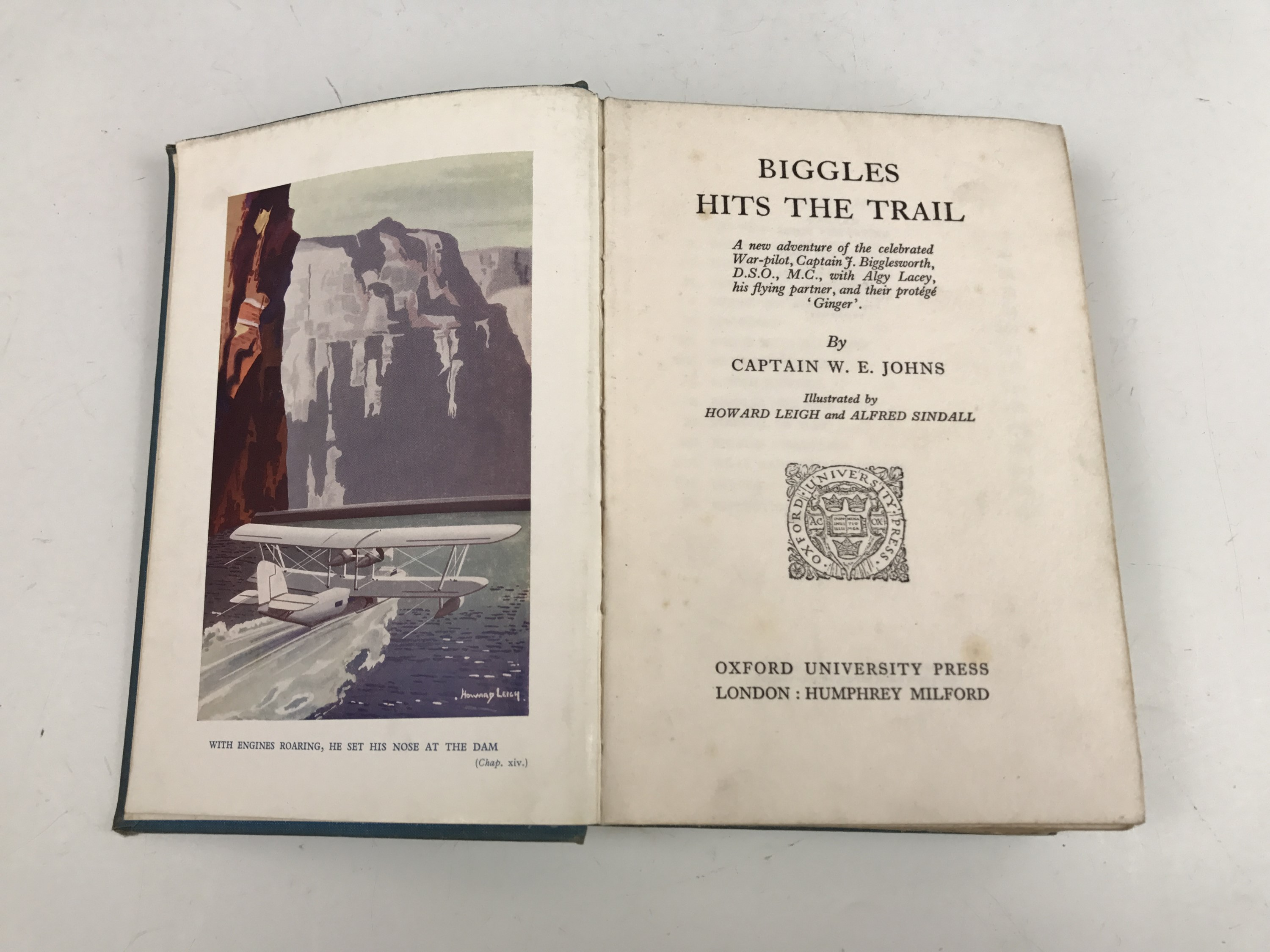 Lot 38 - Johns (Captain W.E.) Biggles Hits the Trail, 1935 and Biggles Goes to War, 1938, 8vo, Oxford