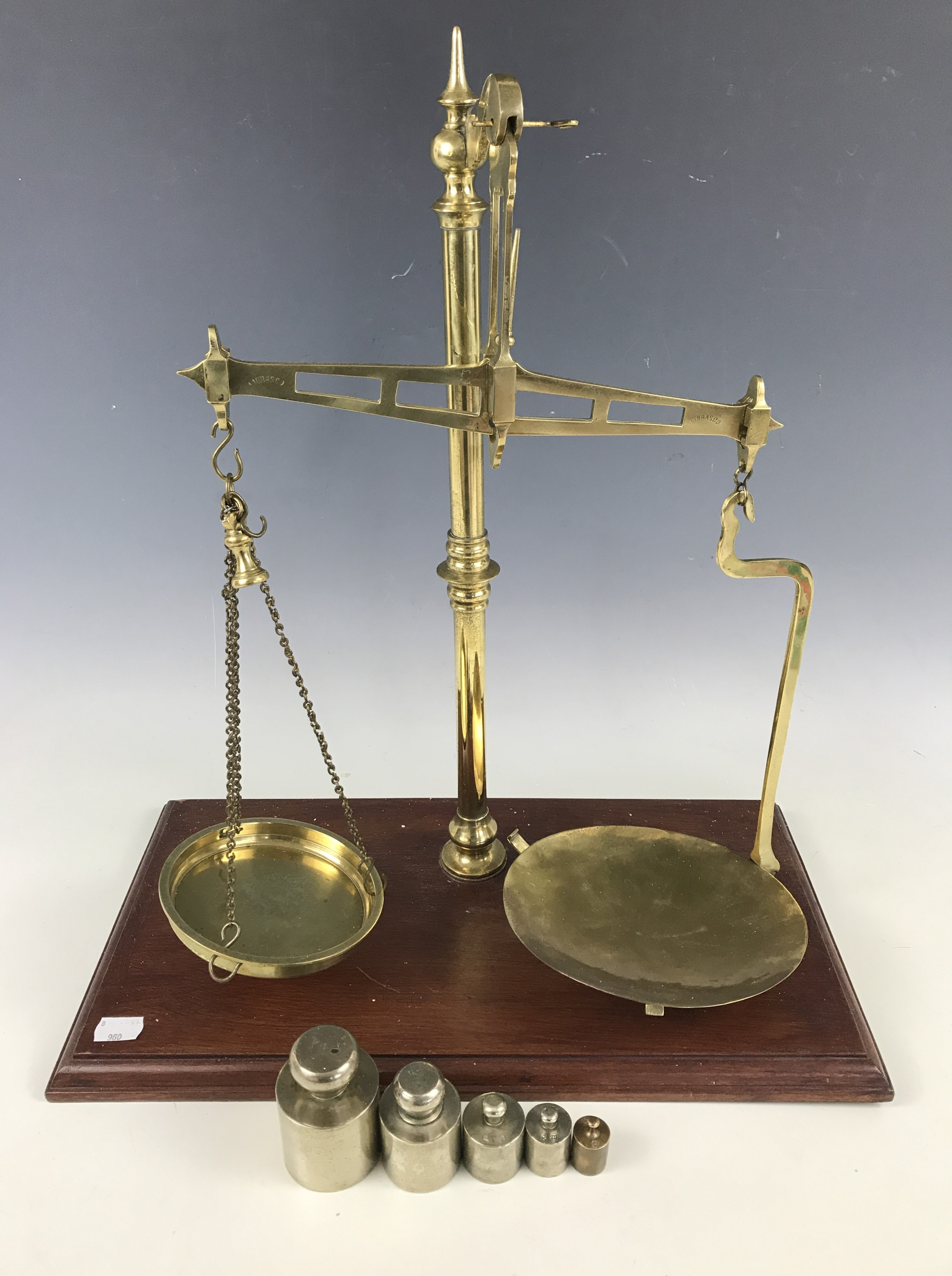 Lot 28 - A set of early 20th Century Librasco brass counter-top beam scales, together with a set of metric ""