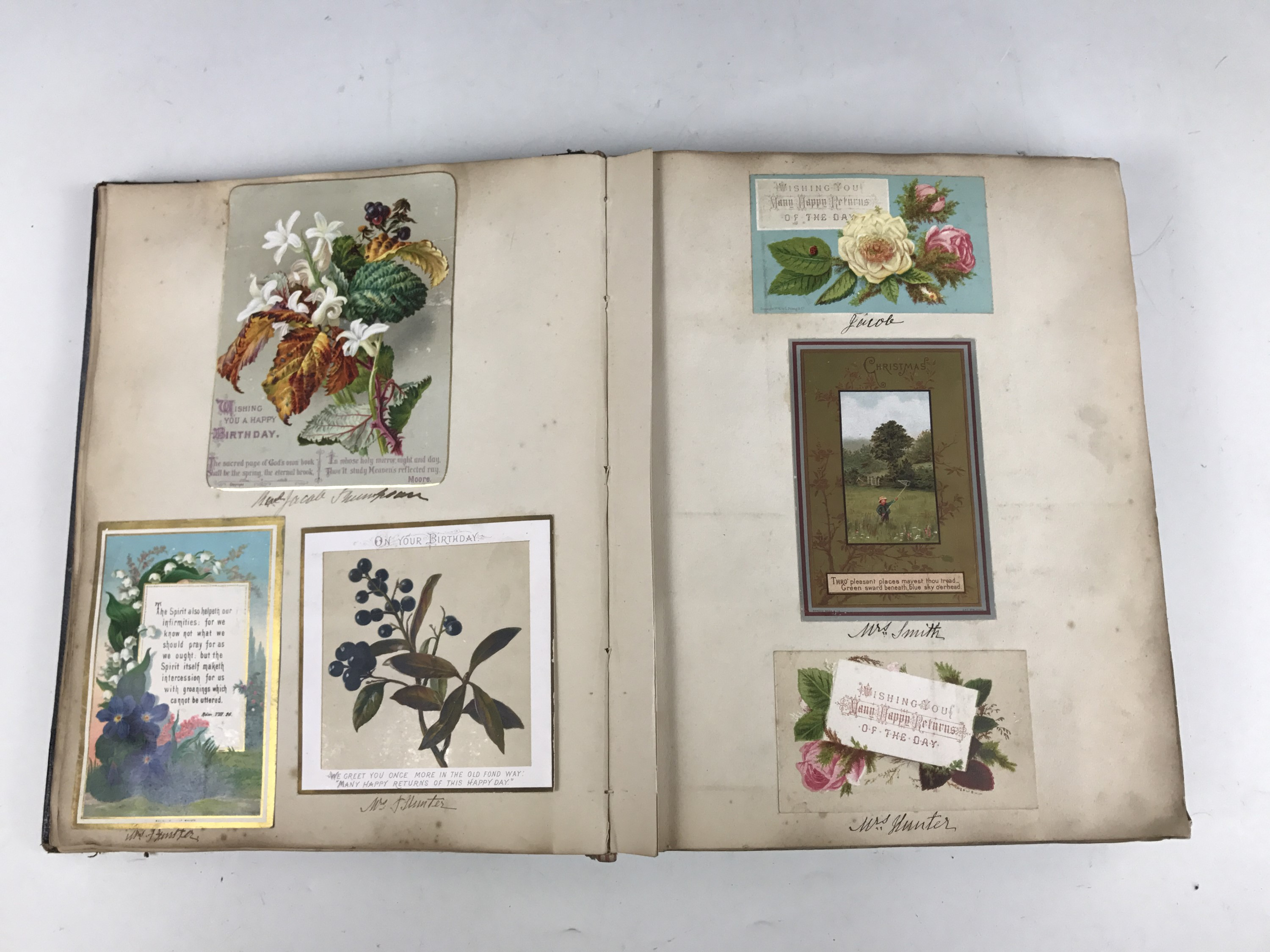 Lot 44 - A late Victorian scrap album containing a collection of tipped-in Christmas cards, each with pen and