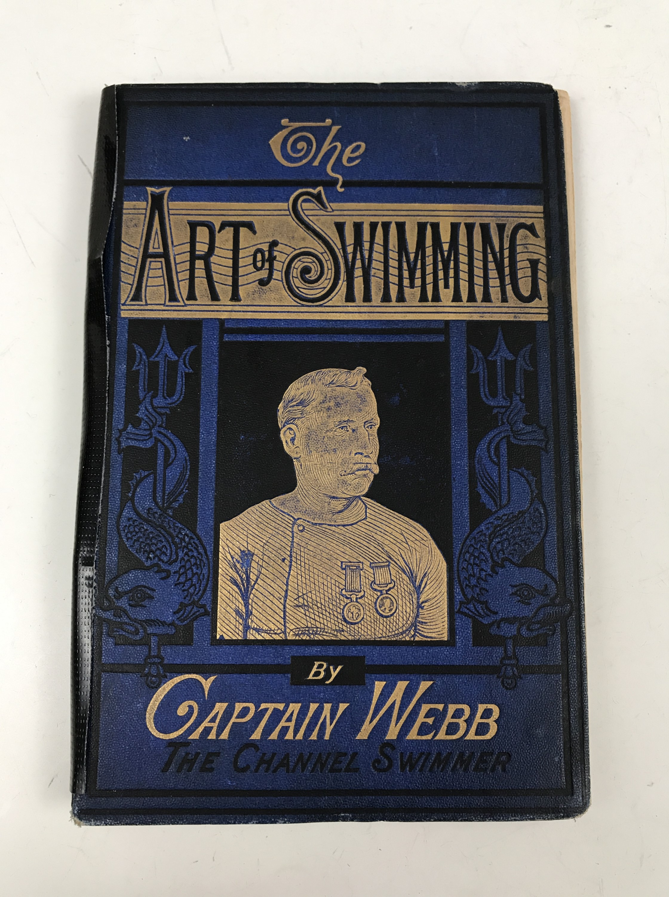 Lot 42A - Captain Webb, The Art of Swimming, first edition, gilt blue cloth pictorial boards and colour