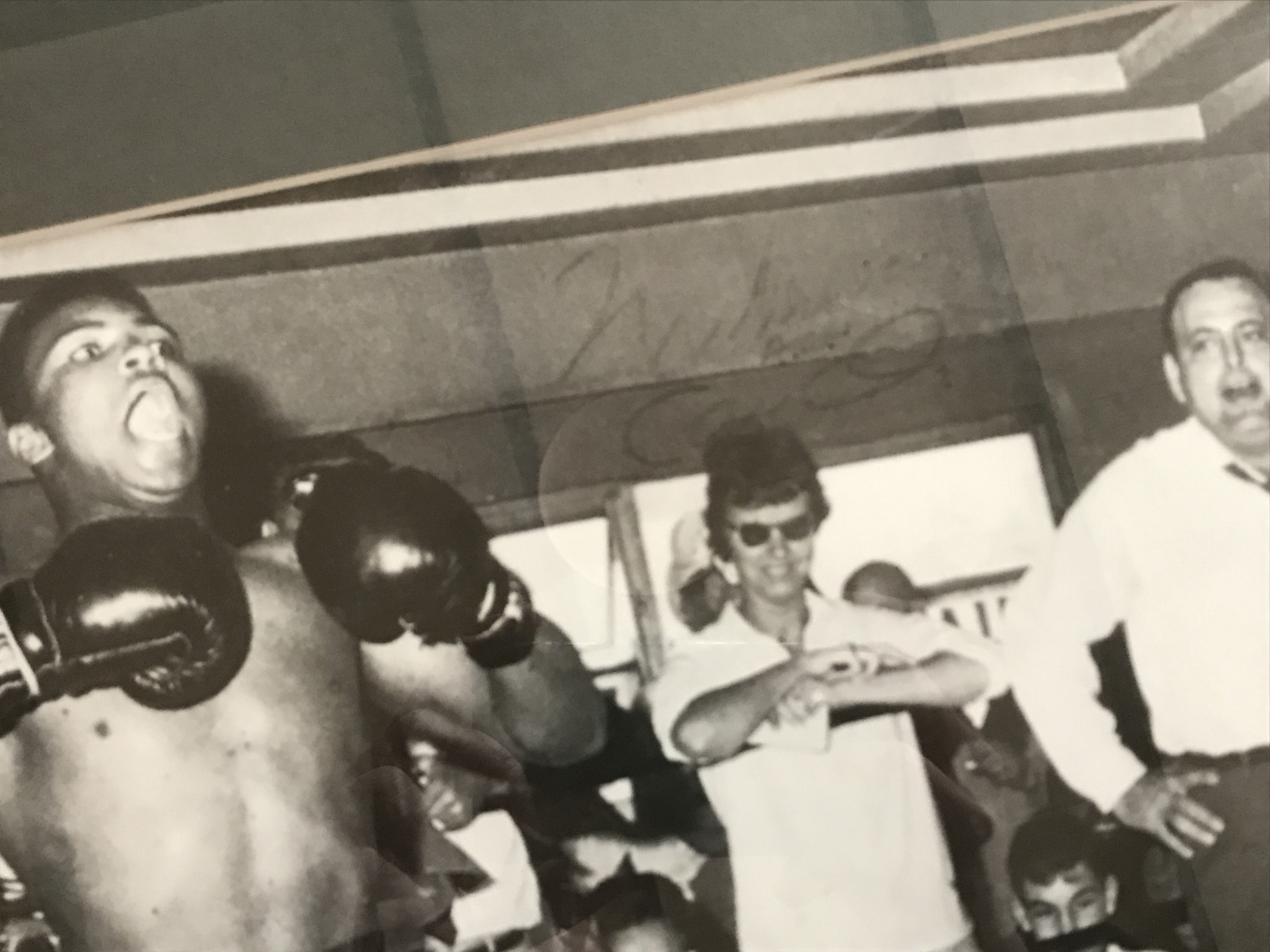Lot 46 - [Autograph / Muhammad Ali / The Beatles] Signed candid photographic print depicting Cassius Clay (