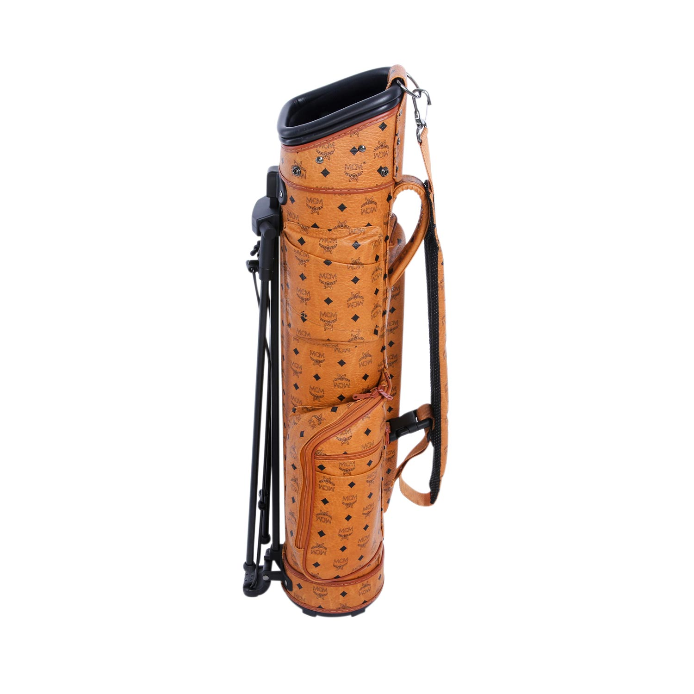 Lot 22 - MCM Golfbag, NP. ca.: 2.500,-€.Visetos Serie in Cognac, diverse Außentaschen, silberfarbene