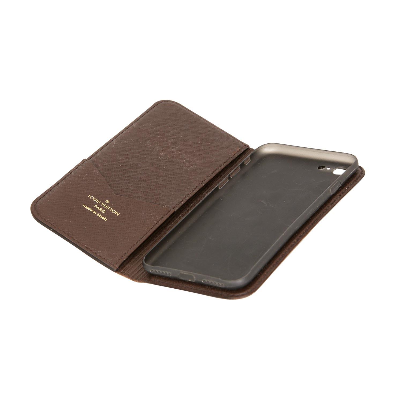Lot 52 - LOUIS VUITTON Handy-Hülle IPhone 7.Monogram Canvas Serie mit Cross-Grain Innenraum mit einem Fach.