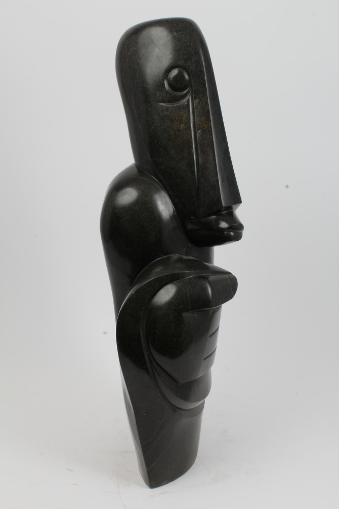 Lot 791 - Moses Masaya (1947 - 1995), a large Zimbabwean Shona School carving of a stylised standing figure,