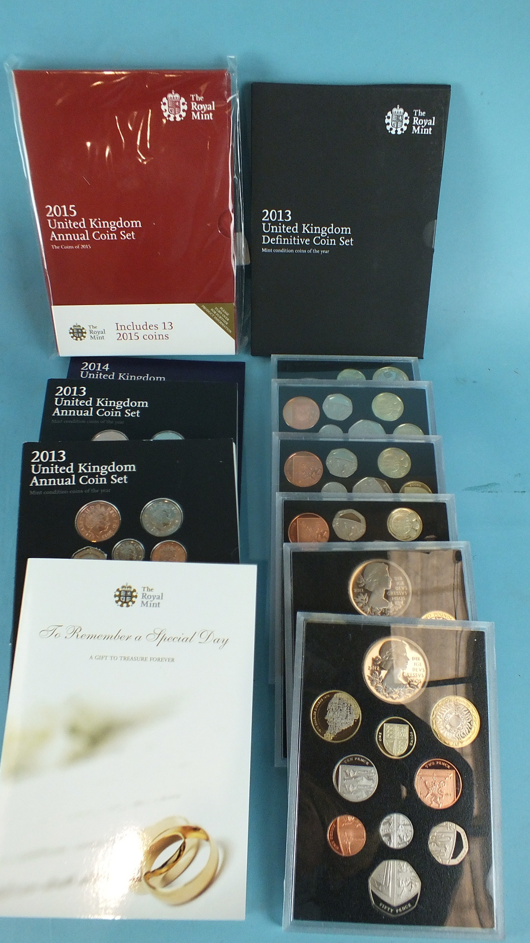 Lot 33 - A collection of six Royal Mint Proof collections: 2010/2011x3/2012x2, two 2013 UK Annual Coin