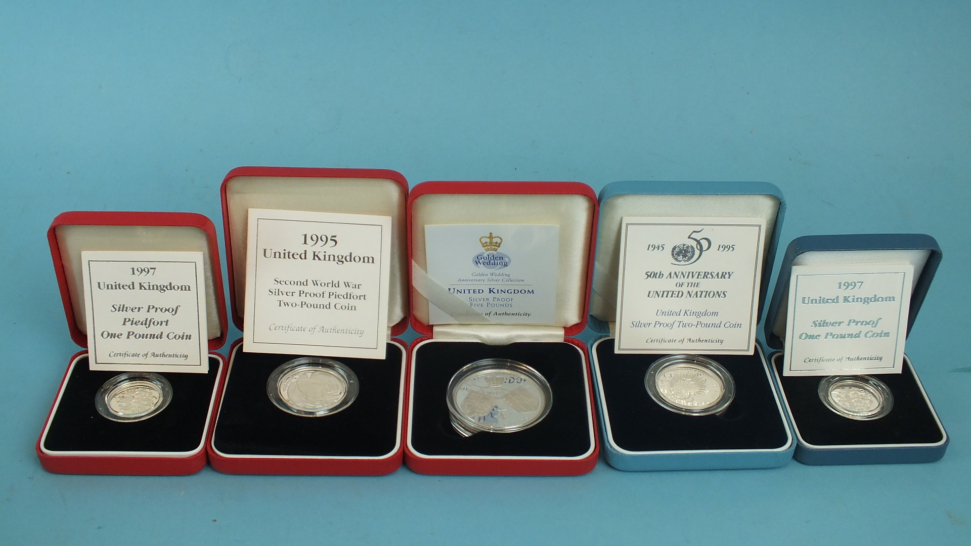 Lot 47 - Five Royal Mint cased coins, including a silver proof 1995 £2 coin, (50th Anniversary of the