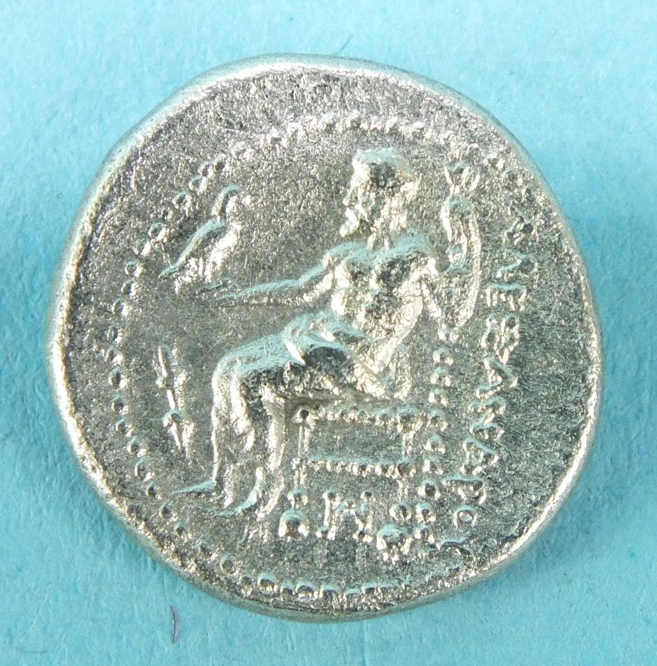 Lot 52 - An Alexander The Great (336-323 BC) silver Drachm, obv. Alexander in lion skin, headdress, rev. Zeus
