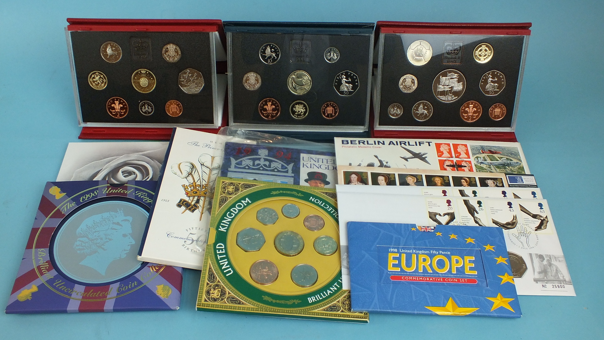 Lot 48 - Three Royal Mint proof coin collections: 1994(8), 1995(8), 1996(9), three Royal Mail BU coin