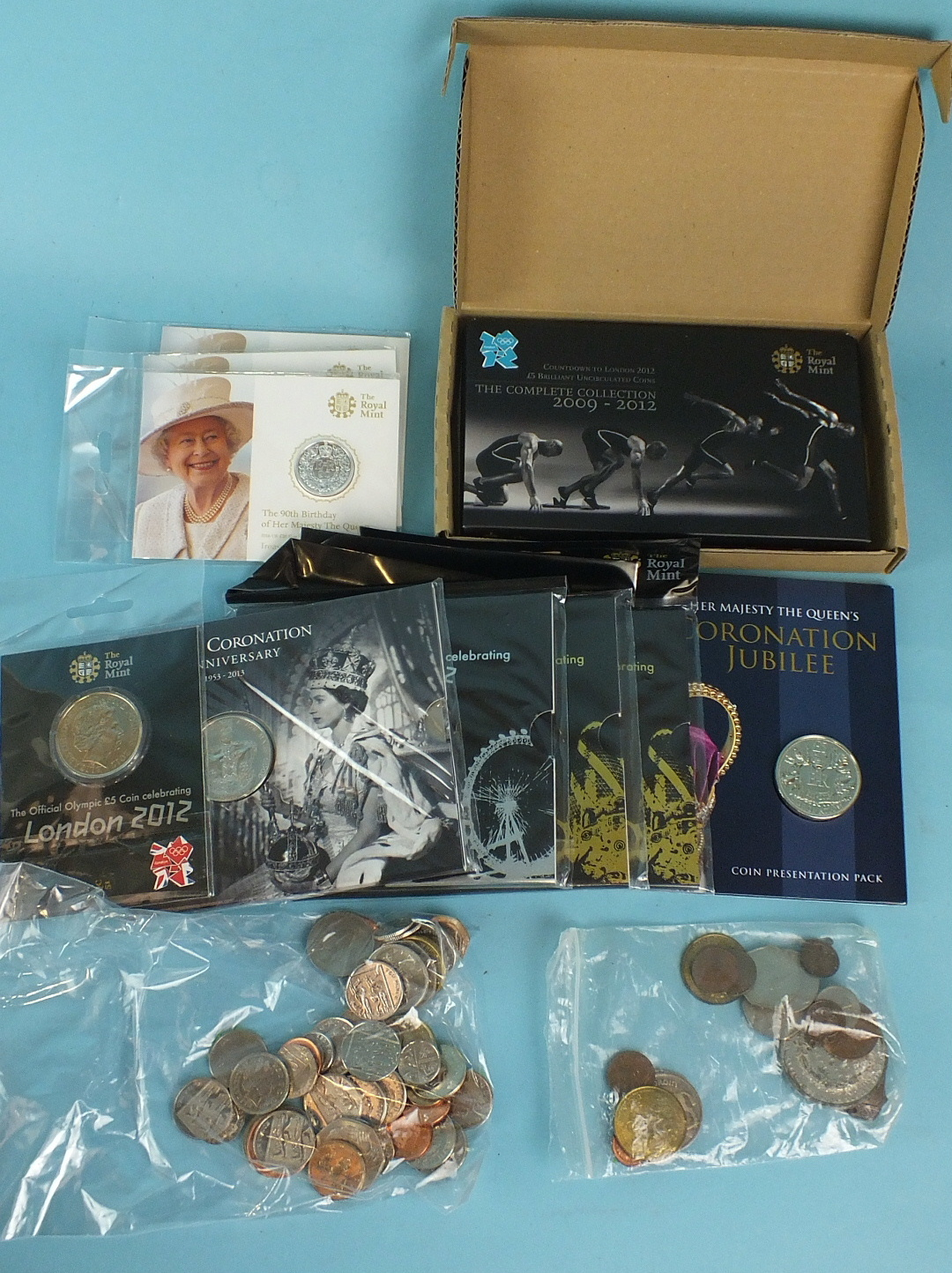 Lot 37 - Three Royal Mint commemorative silver £20 coins: 90th Birthday of Her Majesty The Queen and two