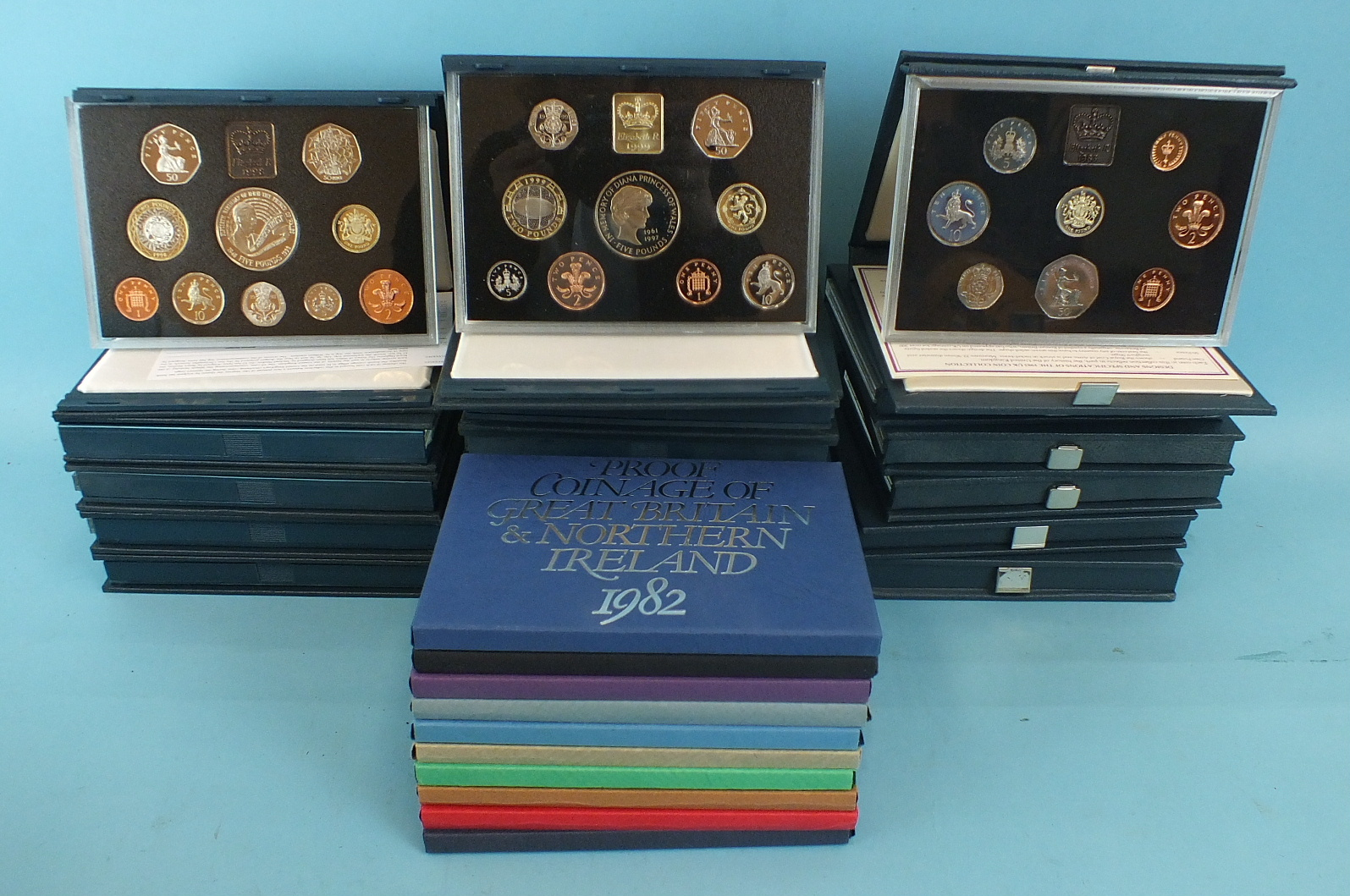 Lot 29 - A collection of twenty-seven Royal Mint Proof collections: 1972-77, 79-99, (27).