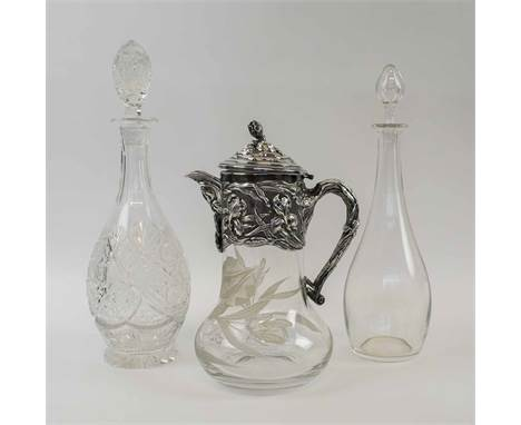 AN ART NOUVEAU STYLE CRYSTAL GLASS, and silver plated lemonade jug, a Baccarat plain glass decanter and a heavily cut glass d