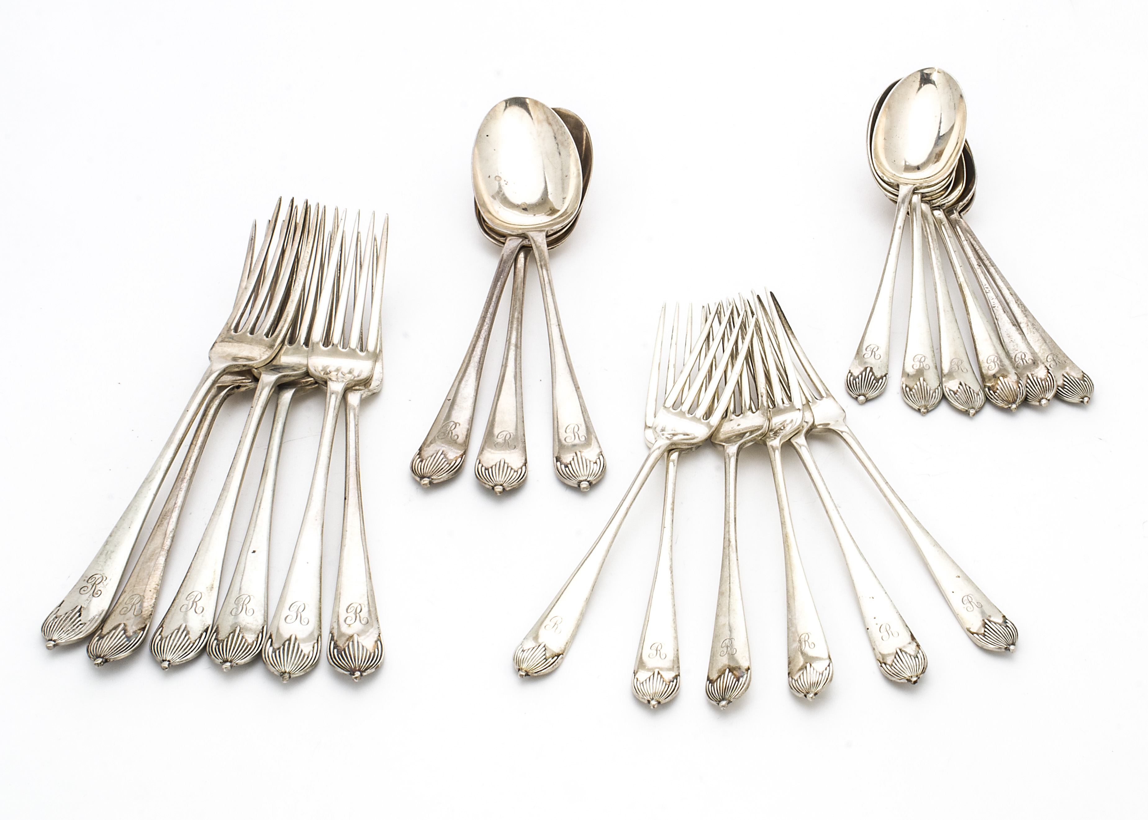 Lot 42 - A George V silver part canteen of cutlery from Mappin & Webb, including three tablespoons, six
