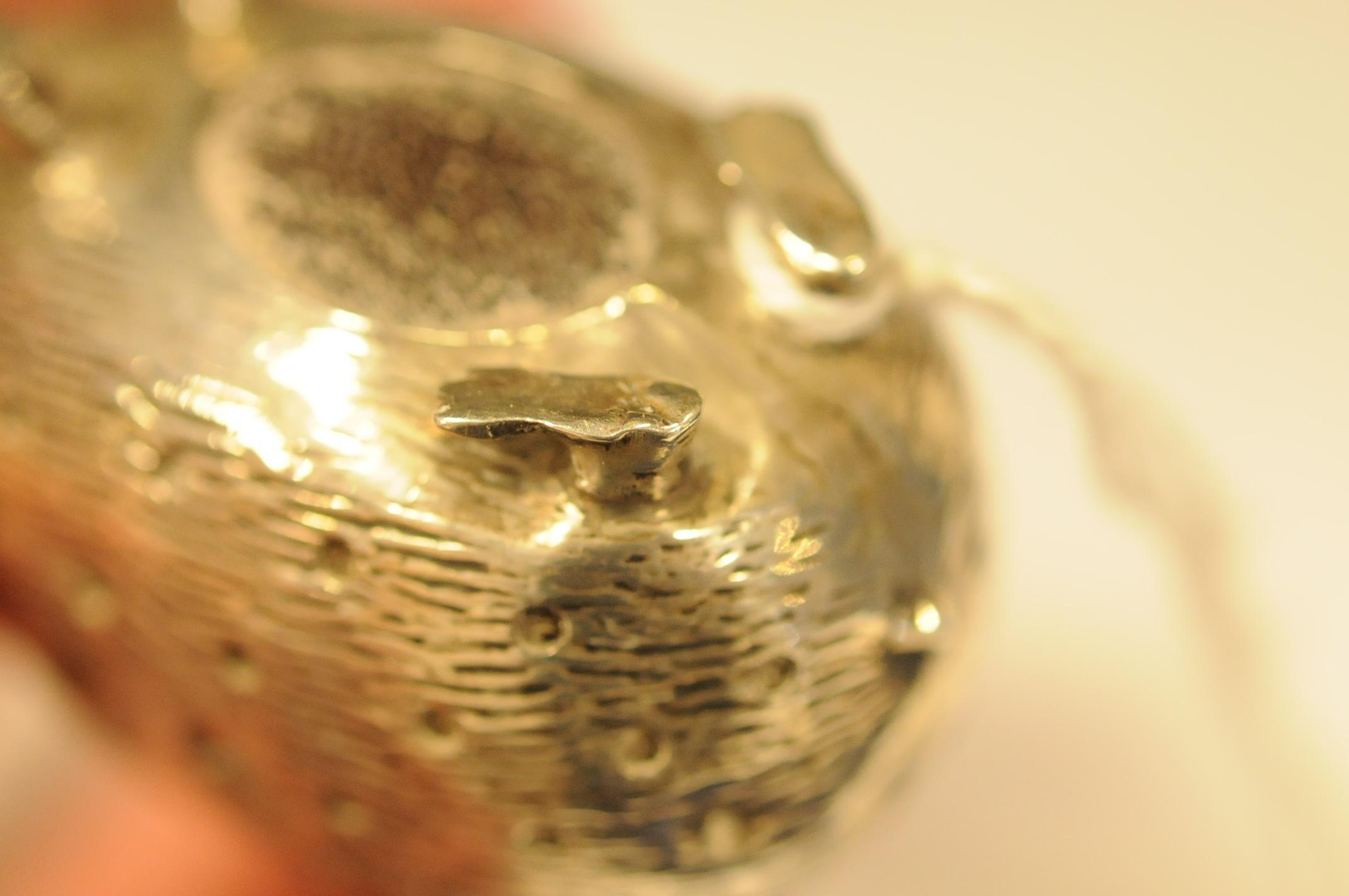 Lot 39 - An Edwardian silver novelty pin cushion by L&S, modelled as a hedgehog, Birmingham 1907