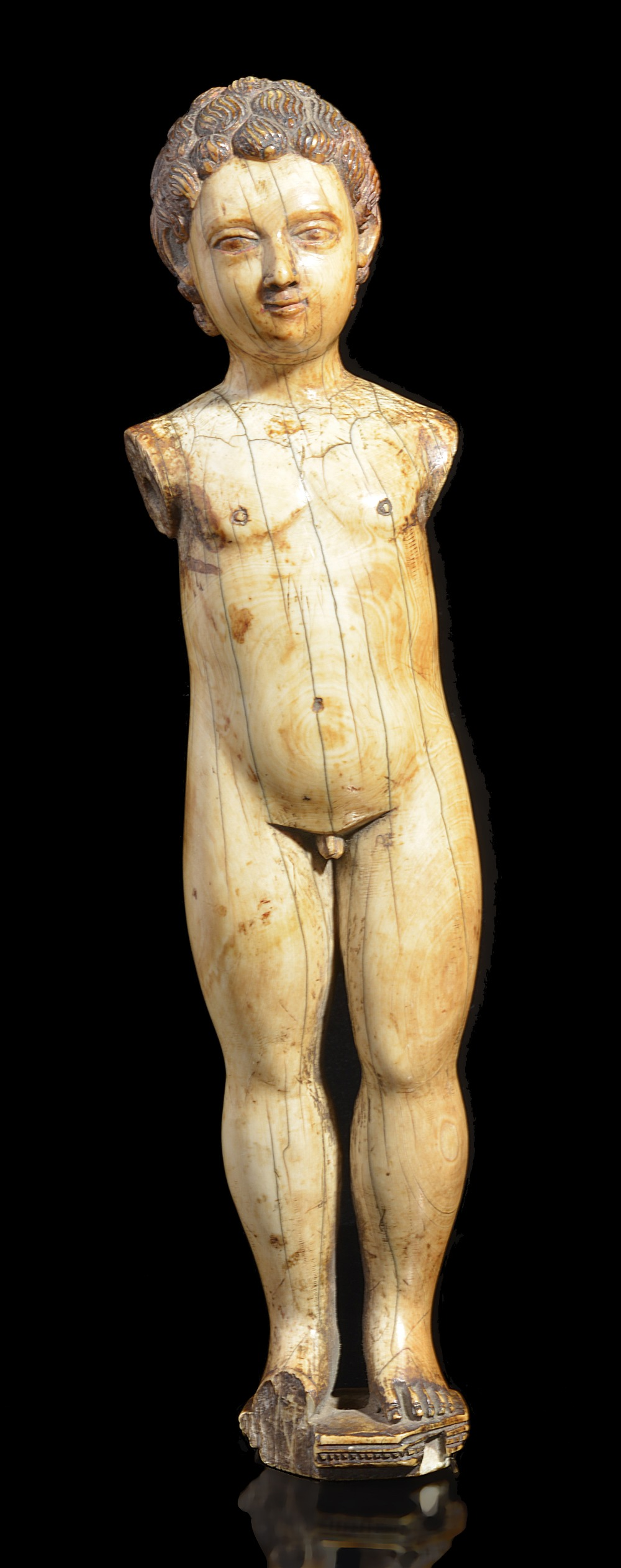 Lot 279 - ~AN IVORY FIGURE OF THE CHRIST CHILD, GOA, 17TH CENTURYcarved standing, the stylised hair and
