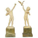 Lot 280 - ~Ferdinand Preiss (1882-1943): 'boy with bow' and 'girl with dove'a pair of German ivory figures,