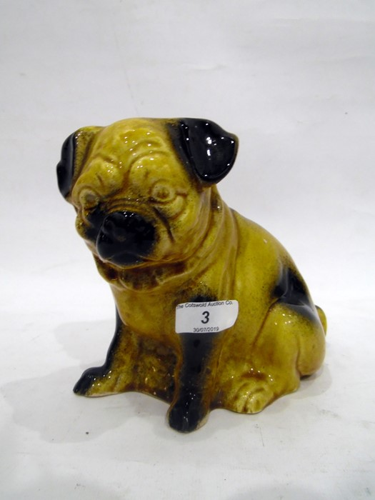 Continental porcelain model of a pug seated on its haunches, 20th century,its fur glazed in ochre