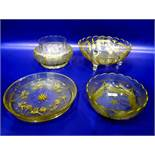 Gilt glass fruit bowl with scalloped edge, floral fern decorated, on three scroll feet, 26cm
