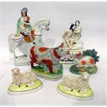 Staffordshire pottery equestrian figure of a Highland bagpiper, a porcelain group of Pero and