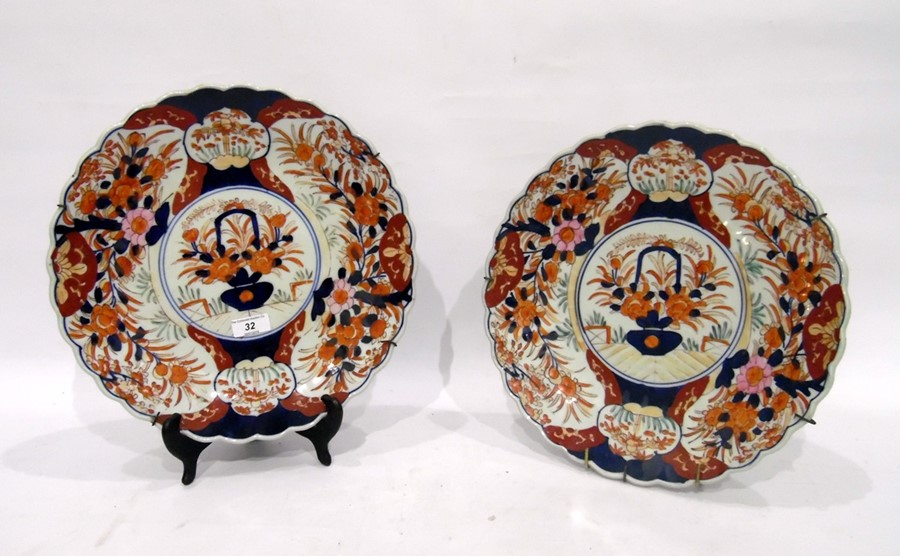 Pair of Imari chargers, late 19th/early 20th century, each painted with a central cartouche and