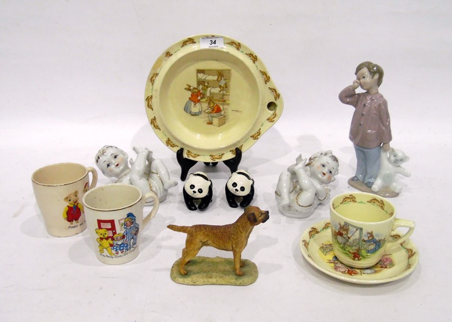 Royal Doulton 'Bunnykins' pattern warmer and a teacup and saucer, printed brown marks, two nursery