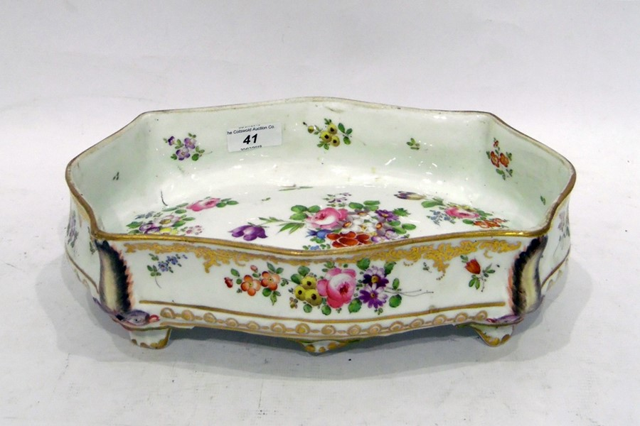 Nantgarw style porcelain dish, rectangular with ogee shape, bombe sides and raised on four
