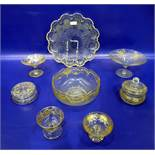 Three gilt glass comports with floral swag and fern decoration, two covered powder bowls, a fruit