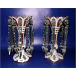 Pair cranberry gilt and white overlay glass lustres, each having shaped scalloped everted rim,