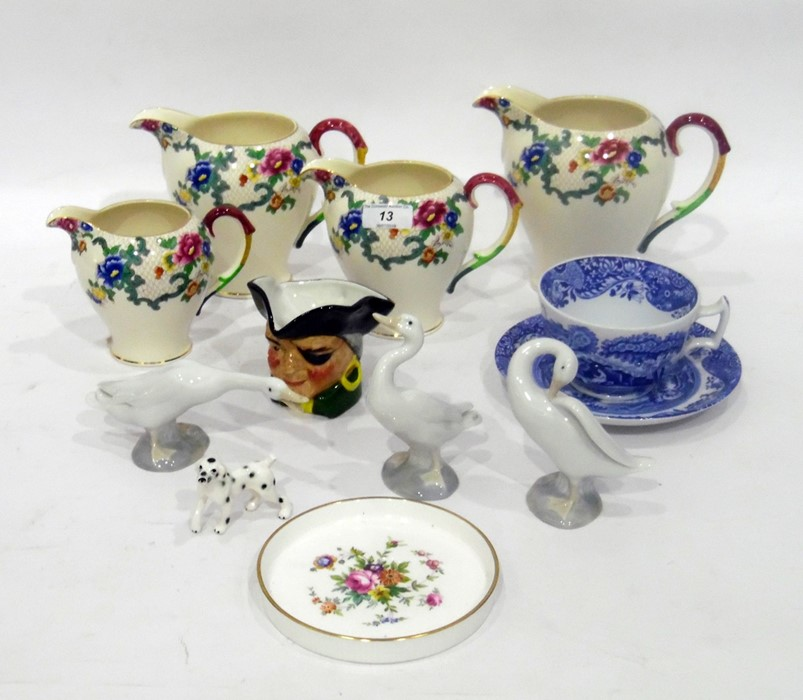 Four Royal Cauldon 'Victoria' pattern jugs in sizes, printed with flowers (the tallest 15cm high),