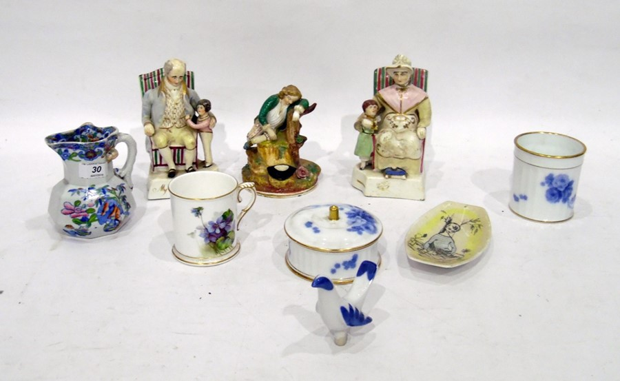 Pair of Staffordshire porcelain seated figures of grandparents and grandchildren- 16 cm. high, a