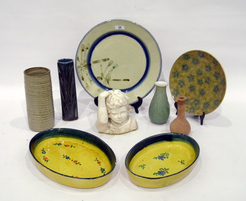 Various items of pottery, to include a tin-glazed bust of a child - 16 cm. high, a pottery charger