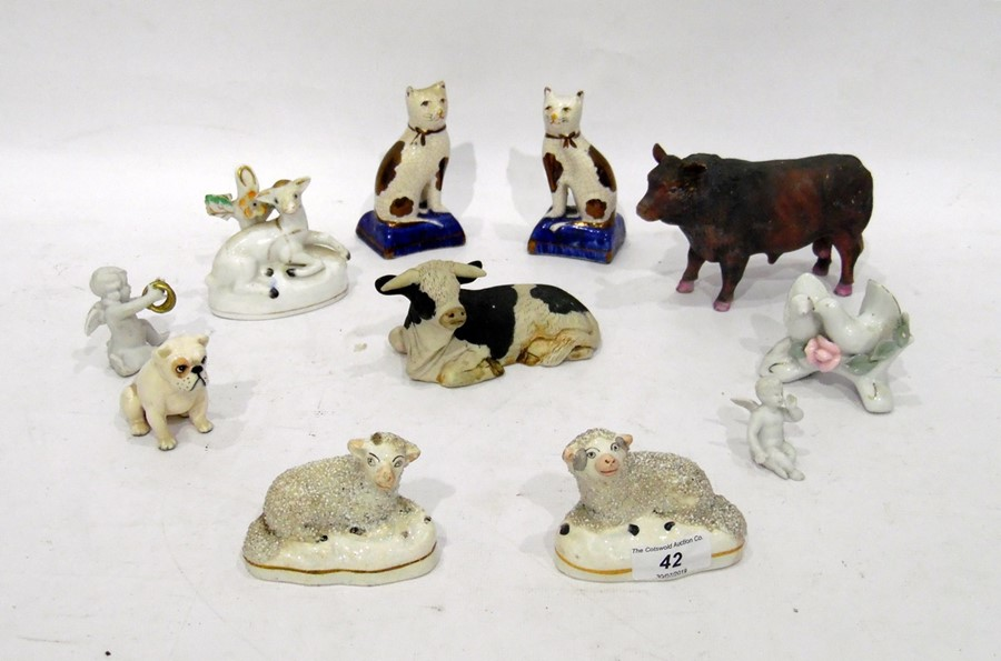 Pair Staffordshire pottery model sheep, Beswick model bulldog in white, 19th century porcelain sheep