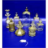 Four gilt glass bottles having gilt decorated shoulders and stoppers, various sizes; agilt