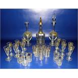 Gilt and clear glass liqueur decanter with floral etched decoration andfive matching liqueur tots