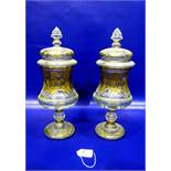 Pair gilt cover pedestal jars, each with pointed finial, cushion shape cover, panelled waisted body,